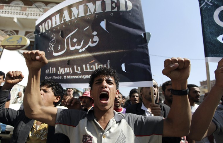 Image: A protester chants slogans during a protest march to the U.S. embassy in Sanaa