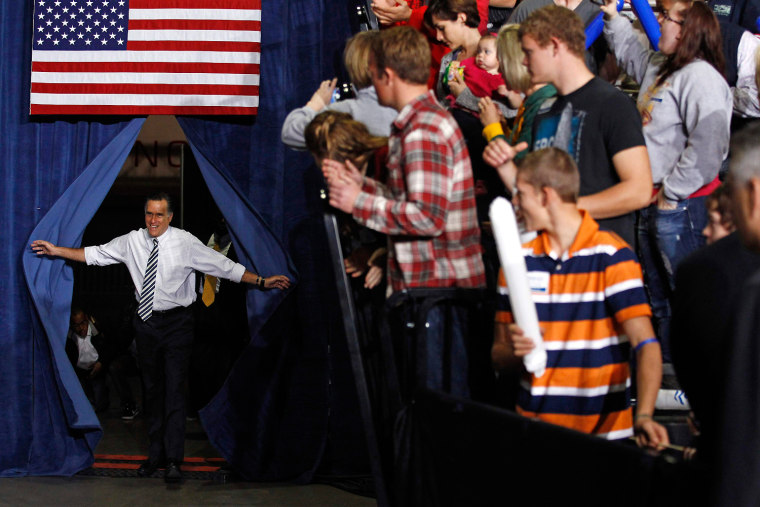 Image: U.S. Republican presidential nominee Romney arrives at a campaign rally in Des Moines, Iowa
