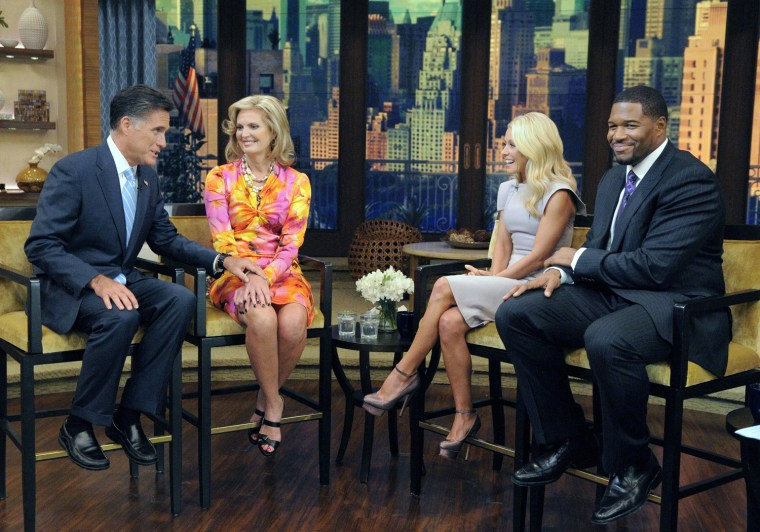 """Image: Handout of Republican presidential candidate Romney and his wife appear on the revamped syndicated talk show, """"LIVE! with Kelly and Michael"""" as they are interviewed by hosts Ripa and Strahan in New York"""