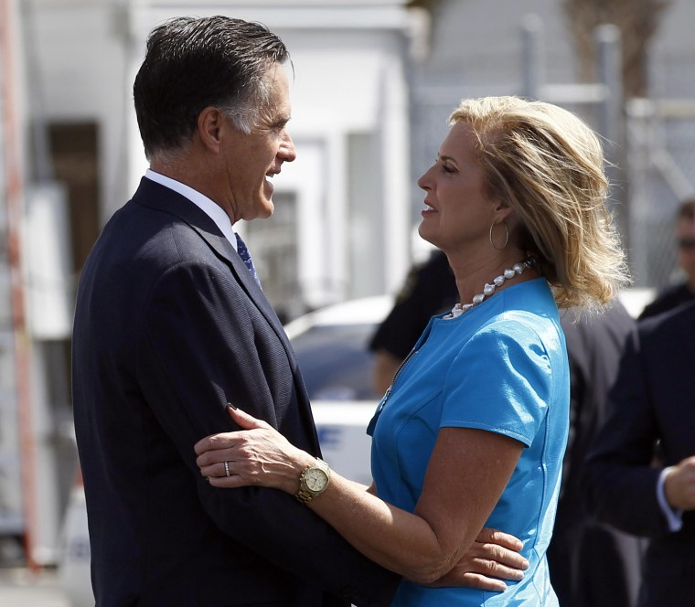 Image: U.S. Republican presidential nominee and former Massachusetts Governor Mitt Romney says goodbye to his wife Ann before boarding his campaign plane in Jacksonville, Florida