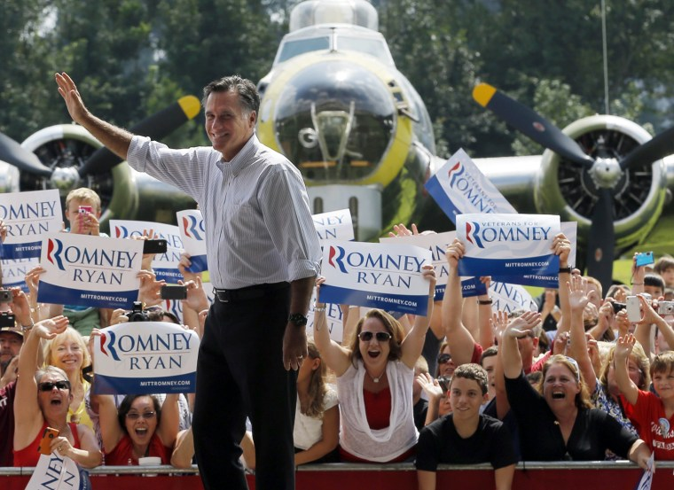 Image: Republican presidential candidate and former Massachusetts Governor Mitt Romney takes the stage at a campaign rally at the Military Aviation Museum in Virginia Beach