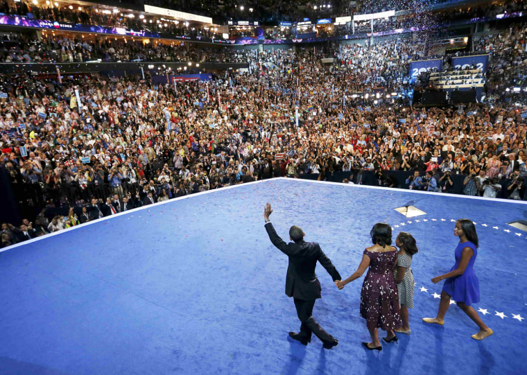 Image: U.S. President Barack Obama waves at supporters as he leads his family - wife Michelle, and daughters Sasha and Malia across the stage at the Democratic National Convention in Charlotte