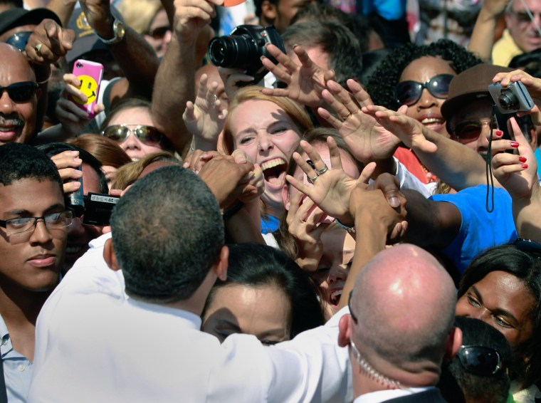 Image: Member of audience reacts as U.S. President Obama shakes her hand at a campaign rally in Woodbridge