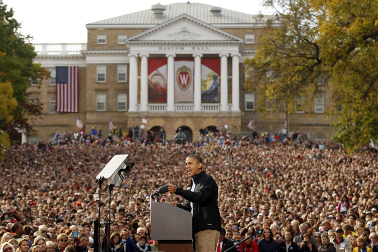 Image: U.S. President Barack Obama speaks to an estimated crowd of 30,000 at a campaign rally in Madison