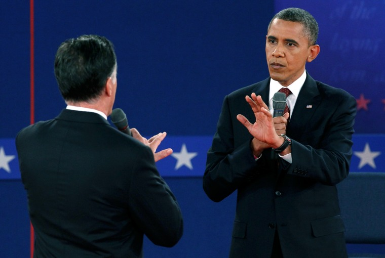 Image: Republican presidential nominee Romney and U.S. President Obama speak directly to each other during the second U.S. presidential campaign debate in Hempstead