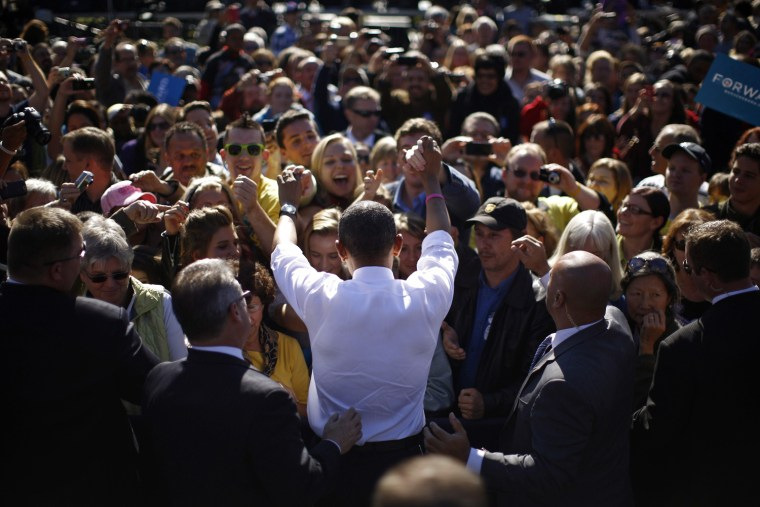 Image: U.S. President Obama greets supporters in the crowd during a campaign rally at Veterans Memorial Park in Manchester