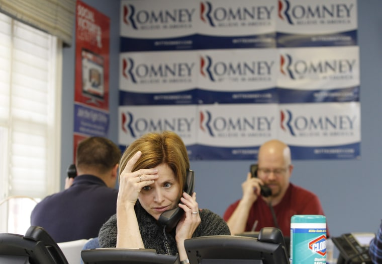 Image: A volunteer for Republican presidential candidate and former Massachusetts Governor Mitt Romney's campaign works the phones at the New Hampshire State Headquarters in Bedford