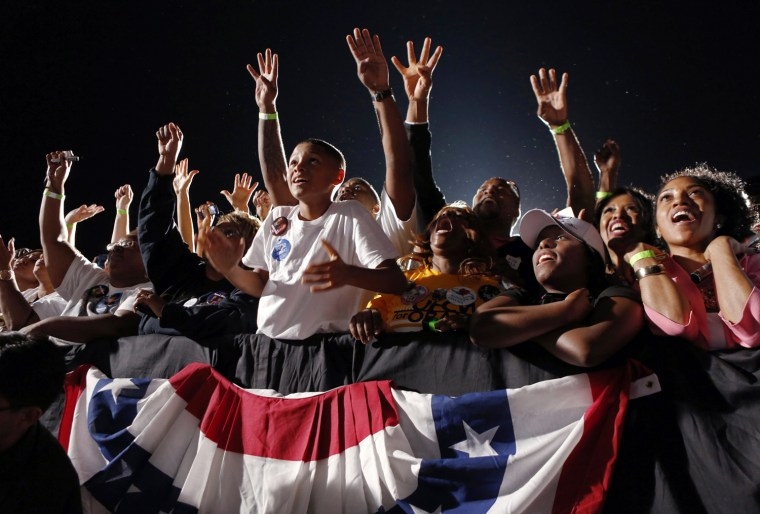 """Image: Boy cheers while others chant """"Four more years"""" as  U.S. President Barack Obama speaks at a campaign rally in Cleveland, Ohio"""