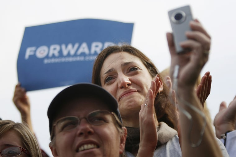 Image: Supporters cheer for Obama at a campaign rally at Elm Street Middle School in Nashua, New Hampshire