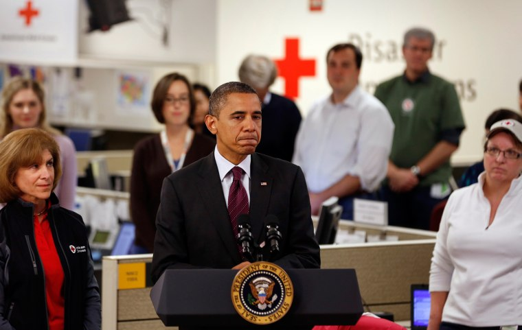 Image: U.S. President Barack Obama speaks while he monitors damage done by Hurricane Sandy at the National Red Cross Headquarters in Washington