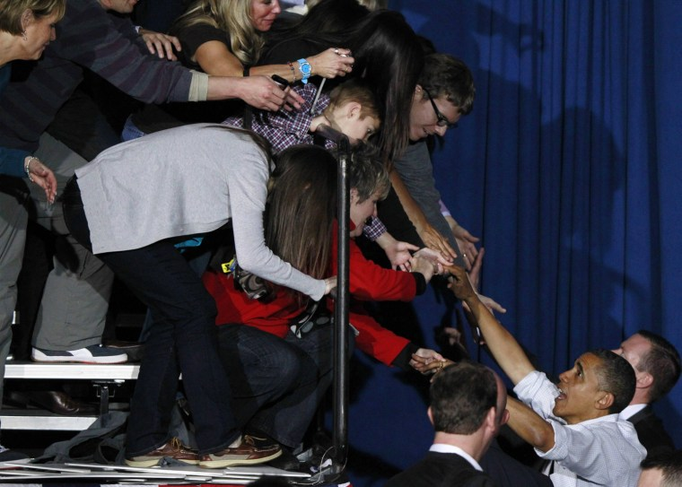 Image: U.S. President Barack Obama greets supporters during a campaign rally at Mentor High School in Mentor