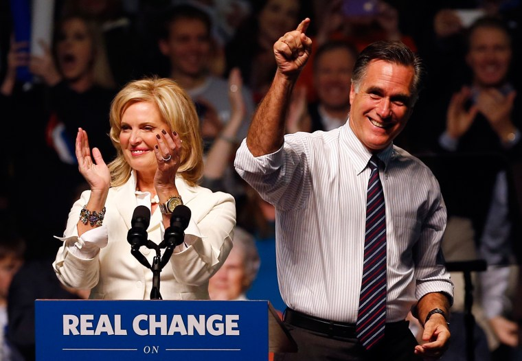 Image: U.S. Republican presidential nominee and former Massachusetts Governor Mitt Romney and his wife Ann at a campaign rally in Manchester, New Hampshire