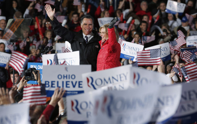 Image: U.S. Republican presidential nominee and former Massachusetts Governor Mitt Romney and his wife Ann attend a campaign rally in Columbus, Ohio