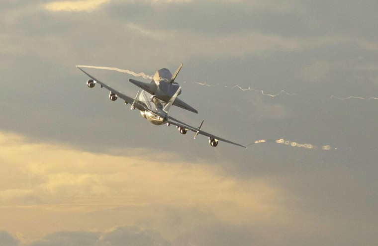 Image: Space shuttle Endeavour atop a modified jumbo jet makes its departure from the Kennedy Space Center,