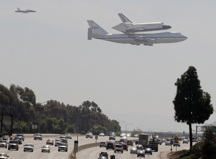 Image: The  Space Shuttle Endeavour arrives on the back of a NASA 747 Shuttle Carrier Aircraft as it passes over the 405 freeway in Los Angeles on a low level flyover at Los Angeles International Airport