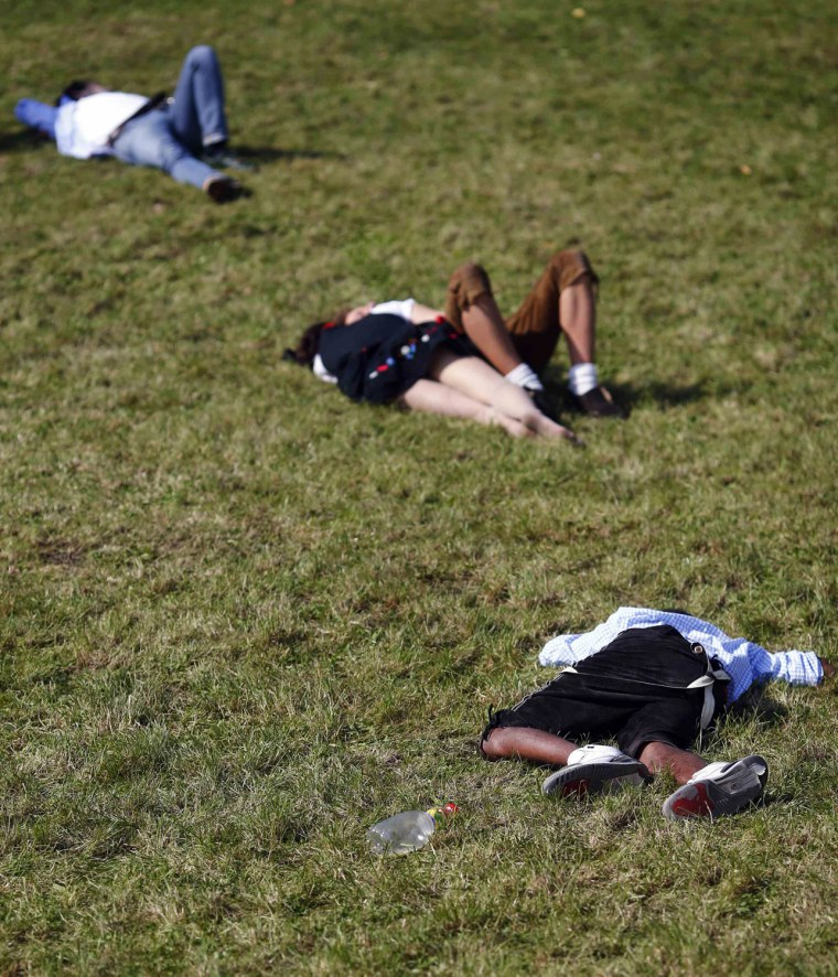 Image: People rest on a meadow during the 179th Oktoberfest in Munich