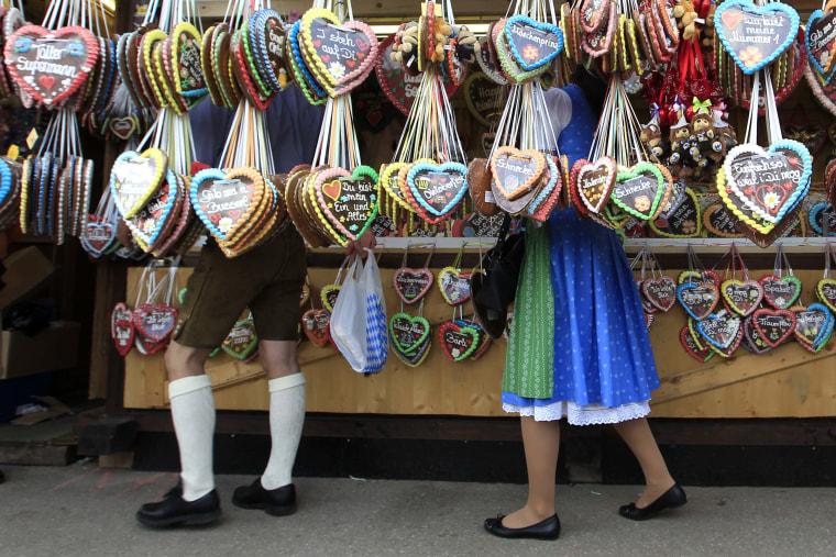 Image: People look at traditional ginger breads at Oktoberfest in Munich