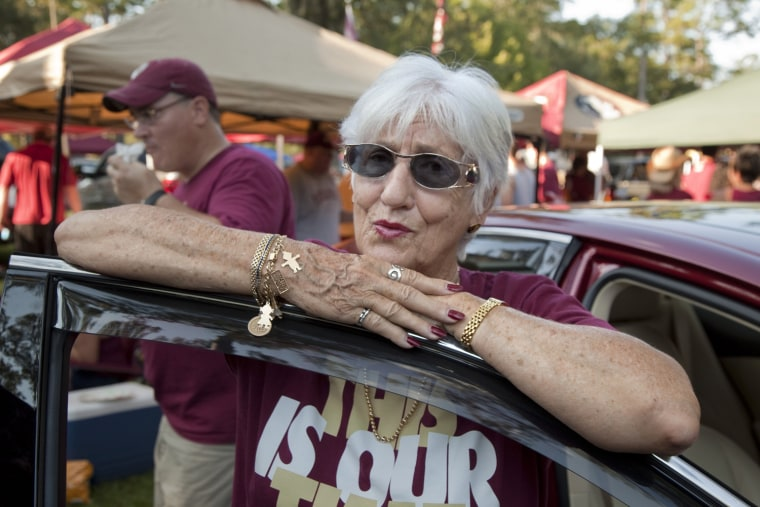Florida, USA, run-up to the 2012 U.S. presidential election. Connie St John, FSU alumni, at a tailgate party in Tallahassee before a big football game. She is a principal administrator in an elementary school. ÒAmericaÕs got to get back on track. I hope a
