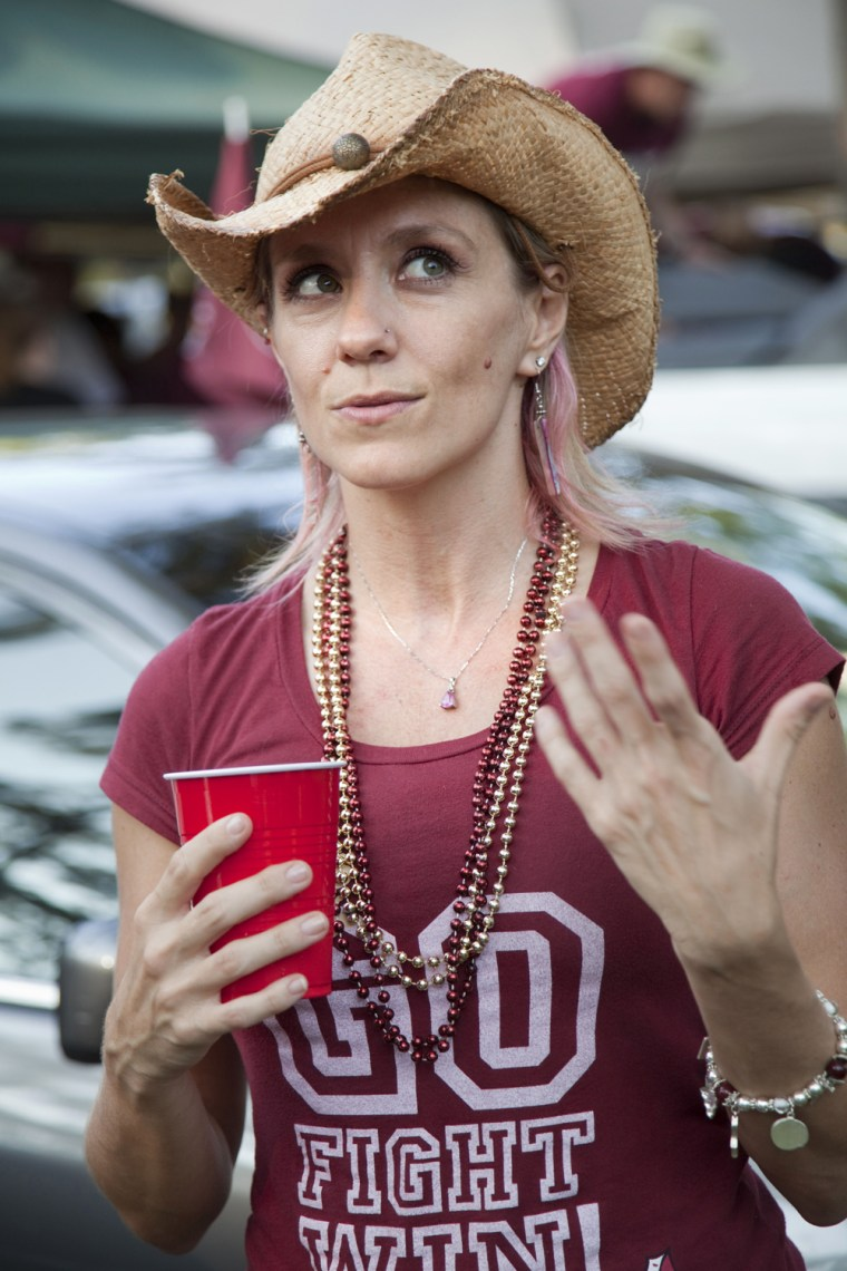 "Florida, USA, run-up to the 2012 U.S. presidential election. Jaime Giroux in Tallahassee at an FSU ""Tailgate"" party before a big football game. Age 36, from Orlando. She works as a green business consultant. Her Republican relatives tease her about Òorgan"
