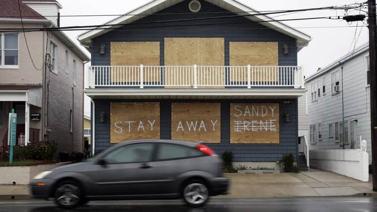 Image: A house on Atlantic Avenue bears a message reflecting the owner's sentiments about the previous hurricane and the approaching Hurricane Sandy in Margate