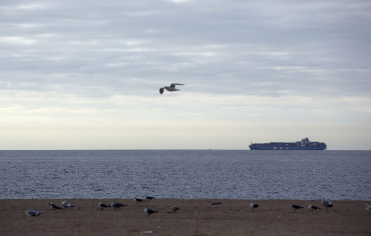 Image: A container ship heads out into the Atlantic Ocean before the arrival of Hurricane Sandy at Coney Island, New York