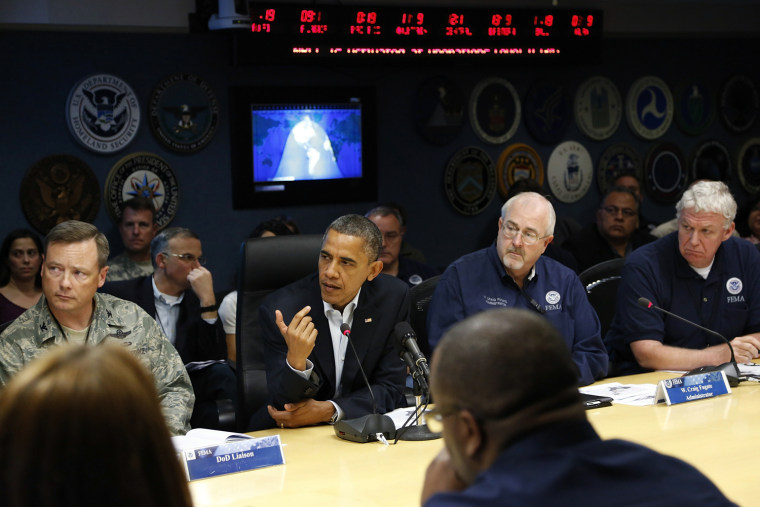 Image: U.S. President Obama asks a question during a briefing about Hurricane Sandy as it threatens the East Coast, at FEMA headquarters in Washington