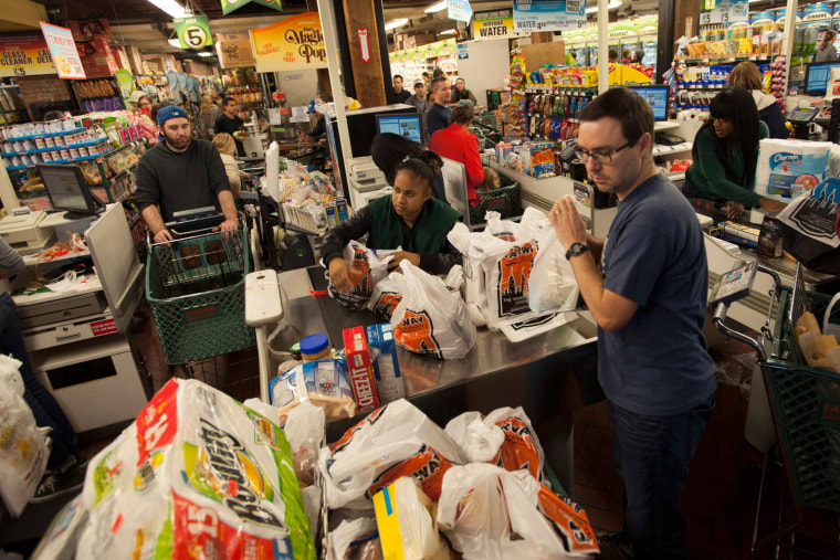 Image: Customers wait in line to buy groceries at the Fairway super market in New York