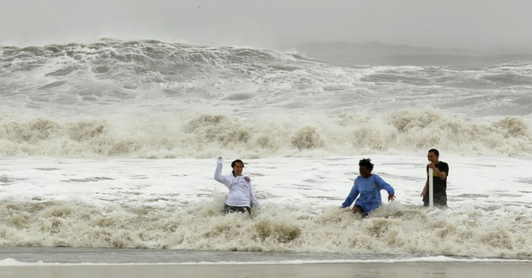 Image: Residents take a dip in the big surf in Ocean City
