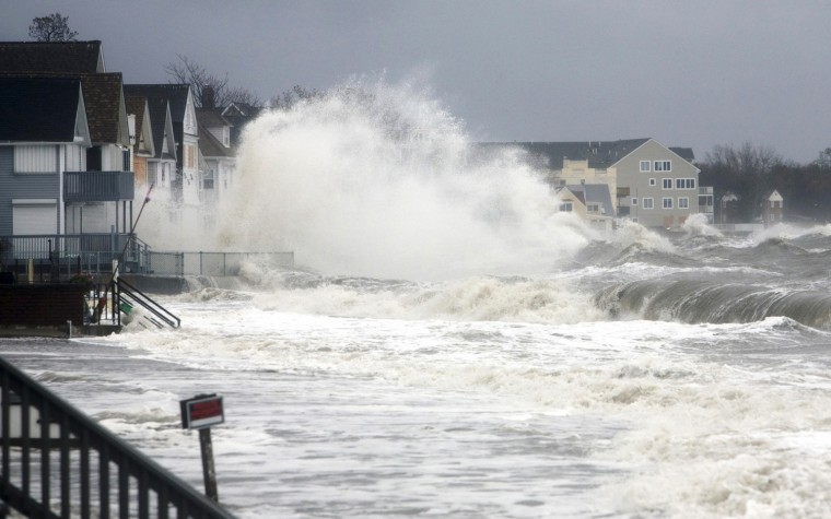 Image: Waves crash over homes along the shoreline in Milford, Connecticut