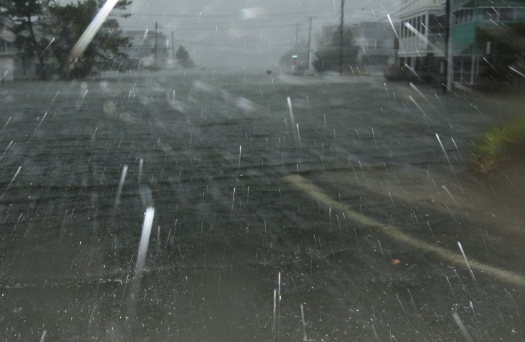 Image: Hurricane Sandy causes street flooding as it comes ashore in Dewey Beach
