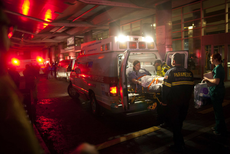 Image: Paramedics evacuate patients from New York University Tisch Hospital due to a power outage as Hurricane Sandy makes its approach in New York