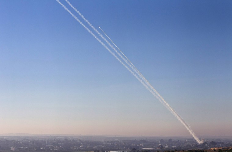 Image: A smoke trail is seen as a rocket is launched from the northern Gaza Strip