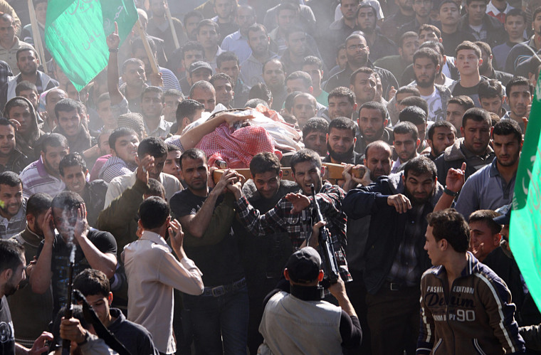 Image: Thousands attend Hamas military commander's funeral