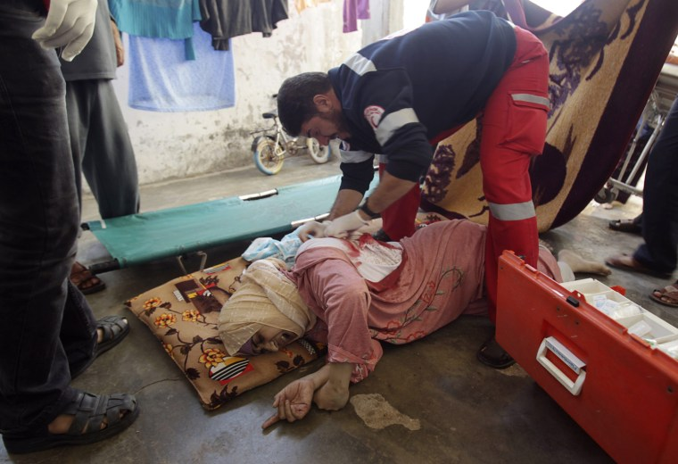 Image: A Palestinian medic tends to a wounded woman after an Israeli air strike in Khan Younis in the southern Gaza Strip