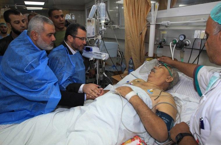 Image: Egyptian Prime Minister Hisham Qandil during a visit to the al-Shifa hospital in Gaza City