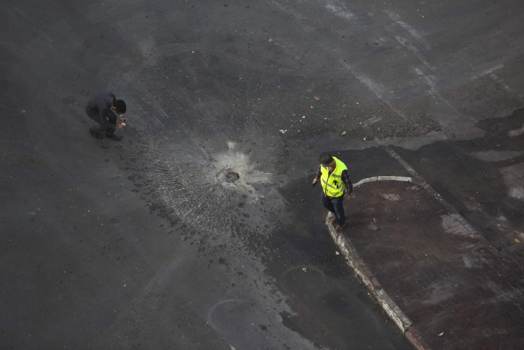 Image: Israeli shoots video at scene after a rocket fired from Gaza landed in Ashdod