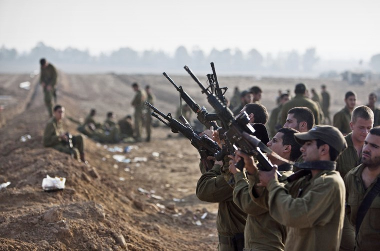 Image: Israeli soldiers check their weapons near border with Gaza