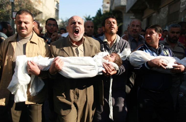 Image: Palestinian carry the bodies of two boys during their funeral in Beit Lahiya in the northern Gaza