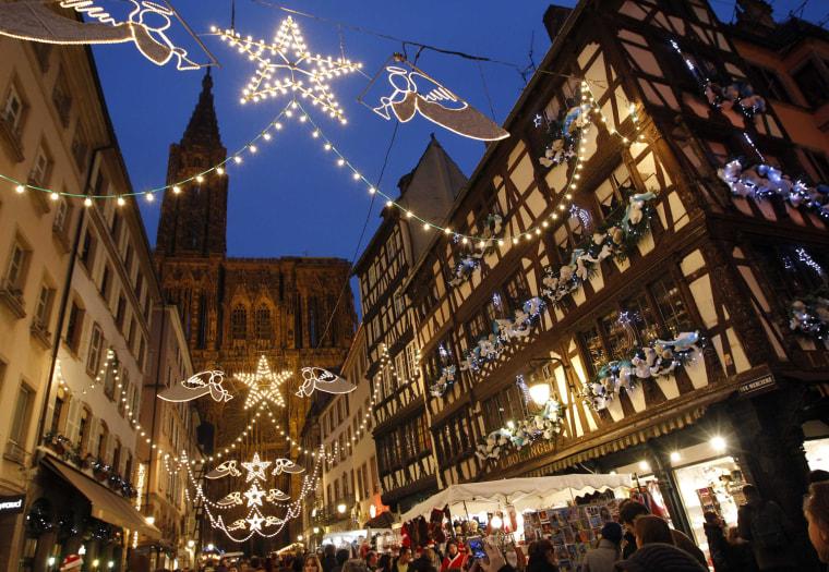 Image: Tourists visit the traditional Christkindelsmaerik (Christ Child market) near Strasbourg Cathedral