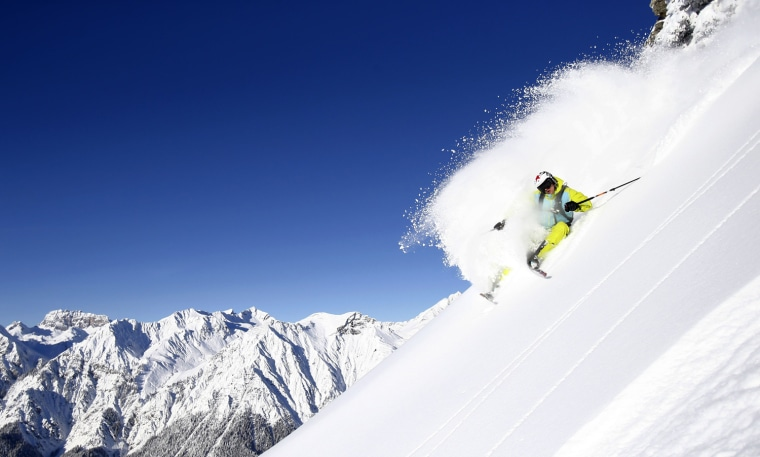 Image: Austrian freeskier Mathias Haunholder makes a turn on a sunny winter day in the western Austrian ski resort of Sonnenkopf mountain in Langen am Arlberg