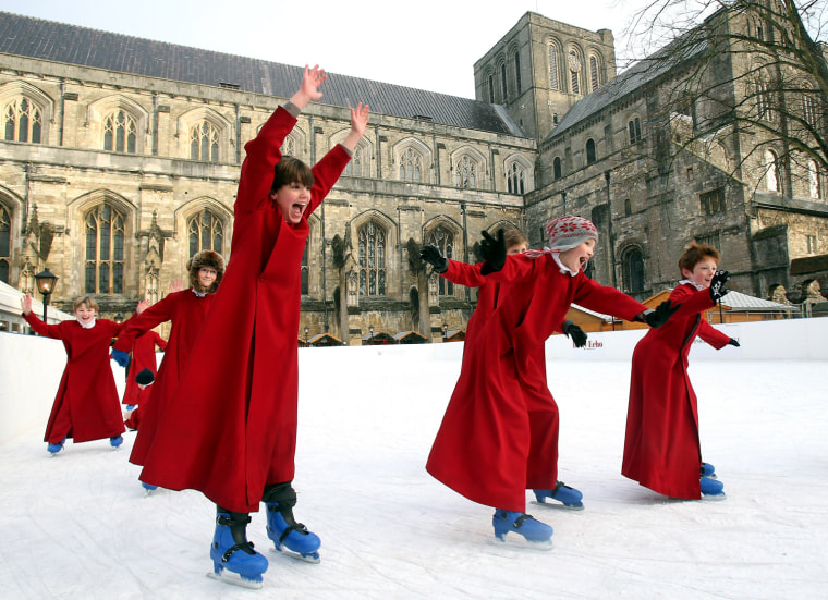 Image: The Boy Choristers Of Winchester Skate On The Cathedral's Ice Rink