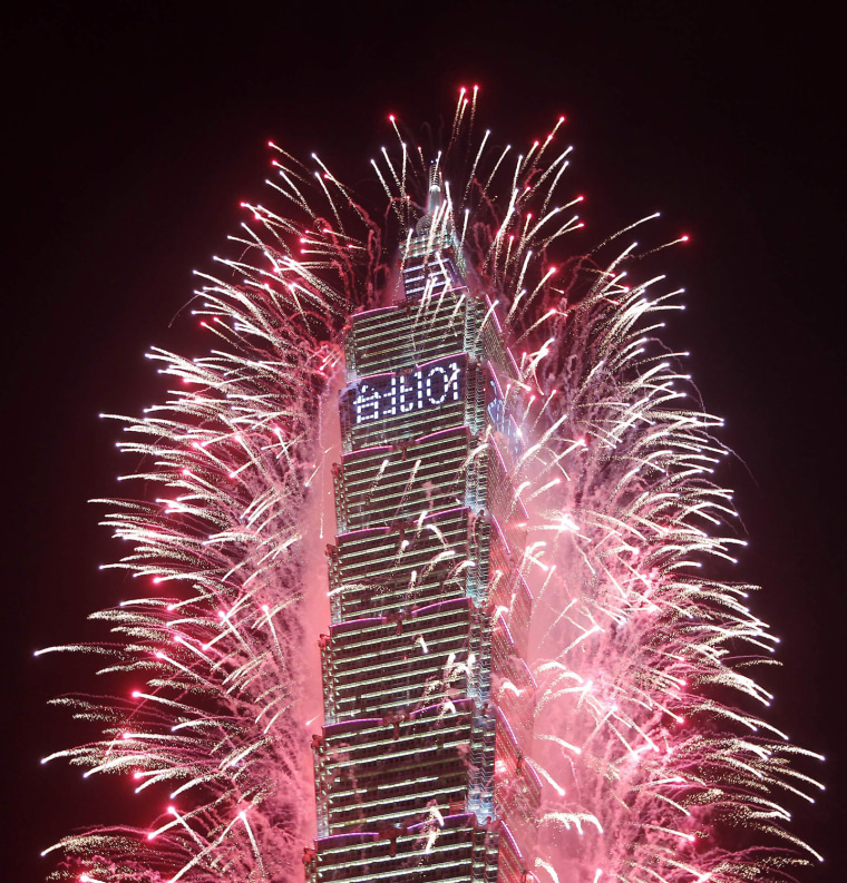 Image: Fireworks explode from Taiwan's tallest skyscraper, the Taipei 101 during New Year celebrations in Taipei