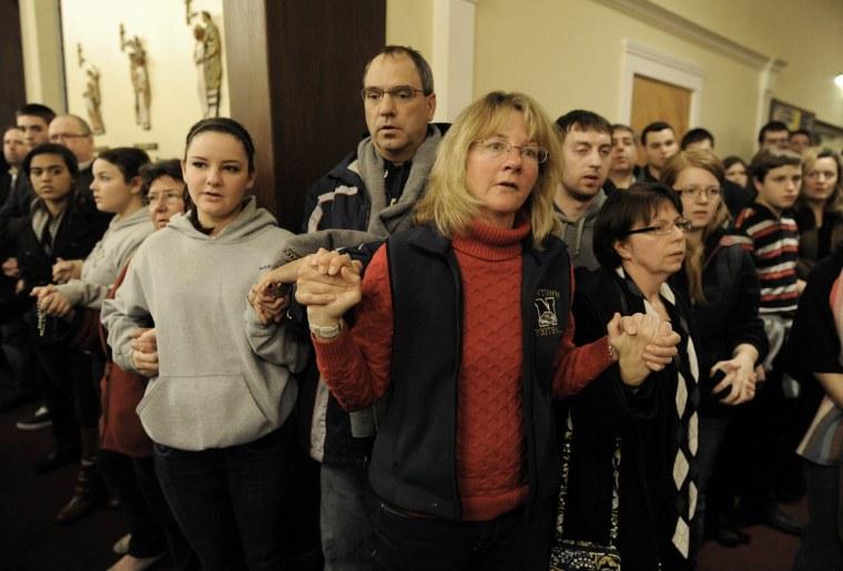Image: Mourners gather inside St. Rose of Lima Roman Catholic Church