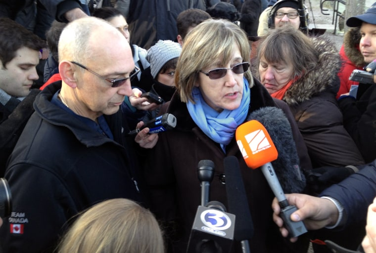 Image: Mary Ann Jacob speaks to the press