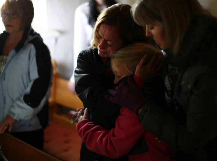 Image: People react during a prayer service at St. John's Episcopal church near Sandy Hook Elementary School in Sandy Hook