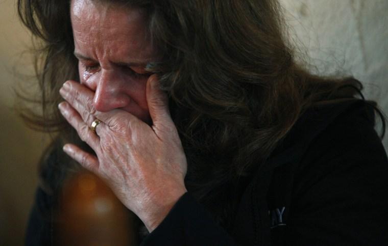 Image: A woman cries during a prayer service at St. John's Episcopal church near Sandy Hook Elementary School in Sandy Hook