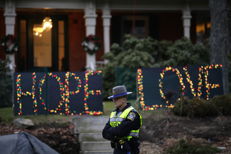 Image: A Connecticut State Police Officer stands at an intersection in Newtown