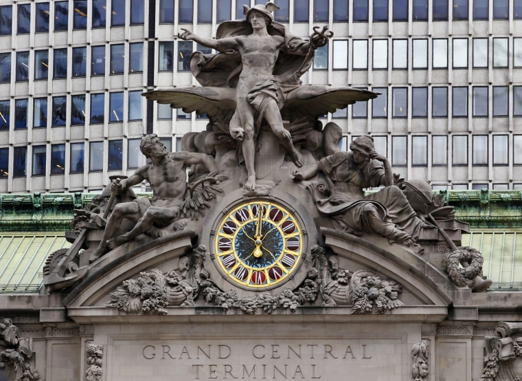 Image: The clock on the south facing side of New York's Grand Central Terminal strikes noon