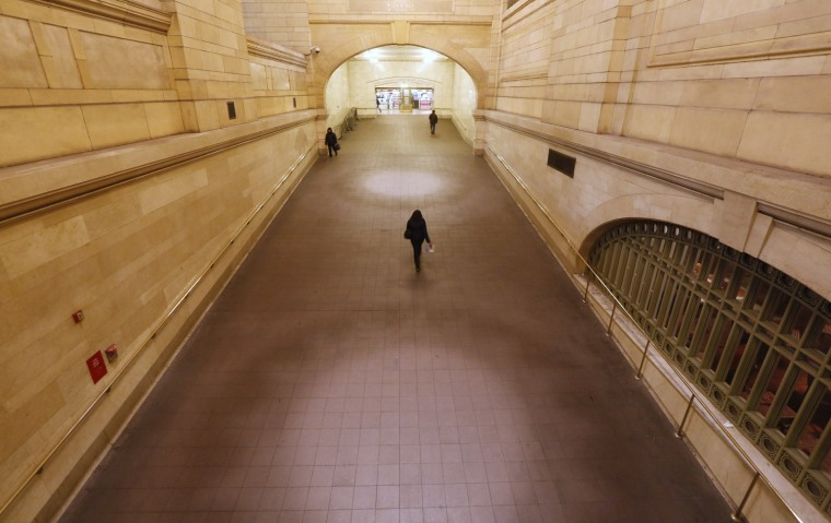 Image: People use the ramp at Grand Central Terminal in New York