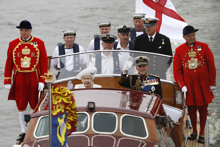 Image: Britain's Queen Elizabeth and Prince Philip wave during a pageant in celebration of the Queen's Diamond Jubilee in London